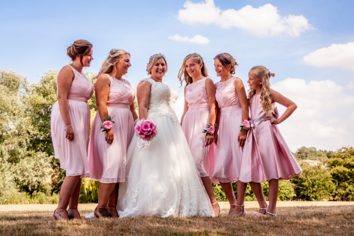 Bride with five bridesmaids dressed in pink